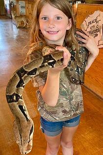 Little girl holding snake.jpeg