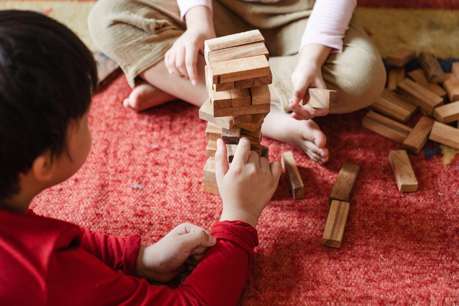 children-playing-jenga-4473566.jpg