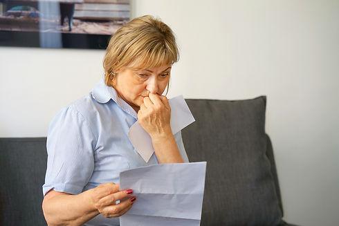 sad woman looking at mail (1).jpg