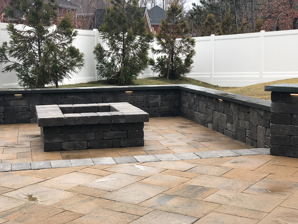 Fire pit with matching seat wall and LED lighting