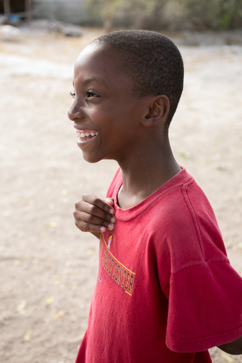 haitian boy laughing