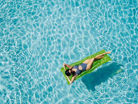 Woman in Pool in South Florida  by Jenny Schartner