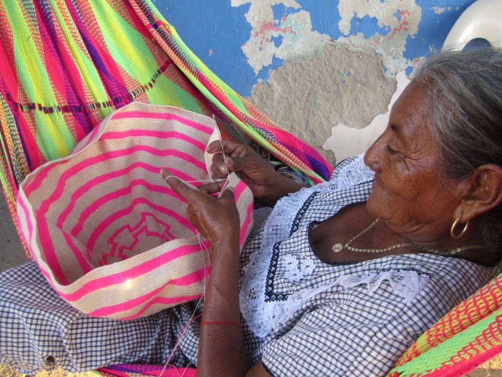 Columbian woman weaving mochila bag