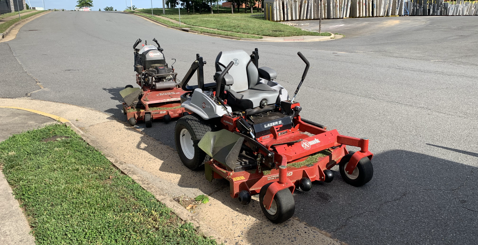 WE USE COMMERCIAL MOWERS