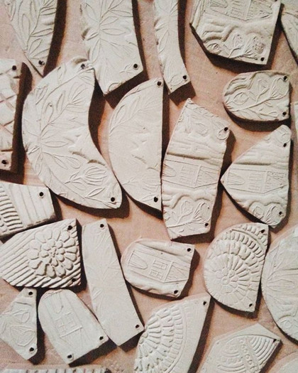 Red clay pendants with pink slip are drying up nicely.jpg