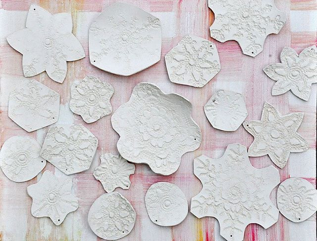 Delicate snowflake ornaments out of their first firing. Soon to be given a coat of clear glaze and a hint of ✨✨✨.jpg