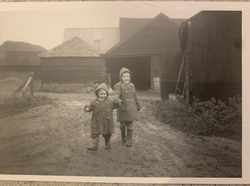My sister and I in the farmyard - Suffolk, UK.