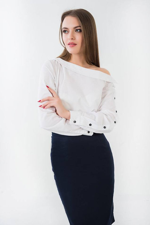 Open shoulder white blouse with black buttons on one sleeve