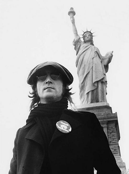 John Lennon in front of The Statue of Liberty. New York City, 1974