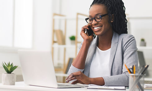 Corporate Communication. Black Businesswoman Talking On Mobile Phone Working On Laptop In