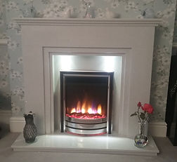 The Seattle suite in white sparkle quartz with Celsi VR electric fire