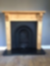 Pine corbel surround with black Prince cast inset & granite hearth
