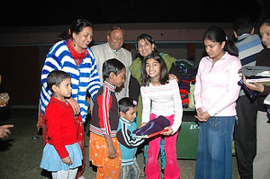 7. Donating sweaters and books.JPG