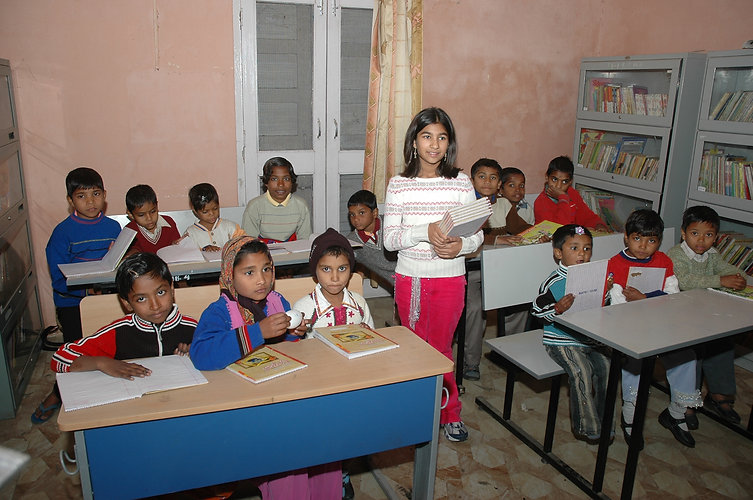 5. Neha in the library she started.JPG