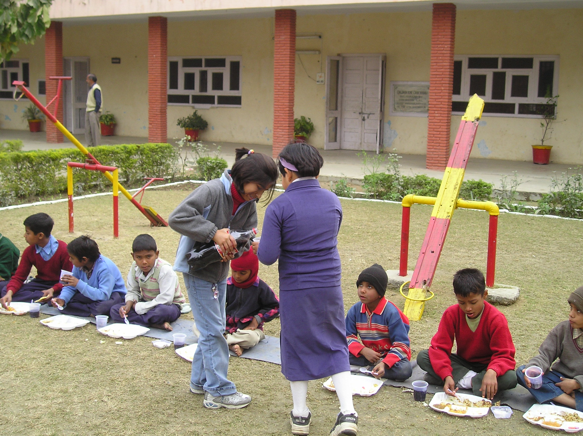 3. Feeding the orphans 2005.JPG