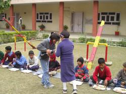 3. Feeding the orphans 2005.JPG