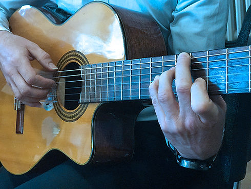 Guitar Hands Blue 600x400.jpg