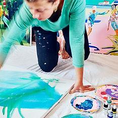 Ruth Mulvie painting in the studio