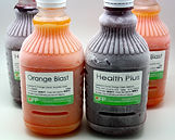 One litre, frozen 'Orange Blast' and 'Healh Plus' cold pressed juices.