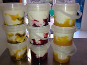 Greek honey yoghurt with passionfruit, strawberry and mango puree.