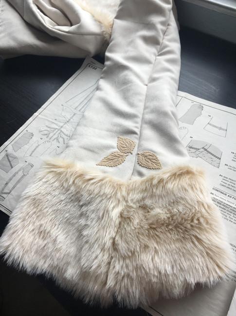 Fur cuff trim with appliqued leaves