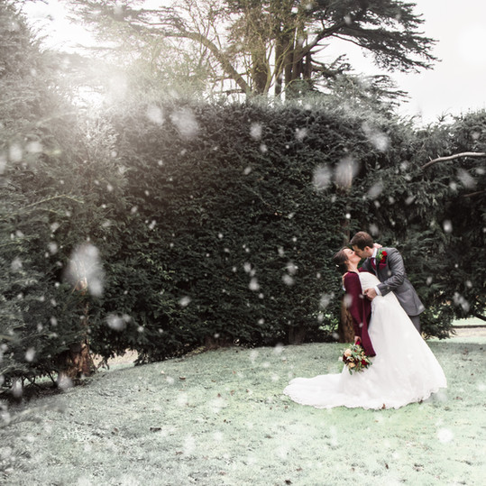 Bride-Groom-Kiss-Snow