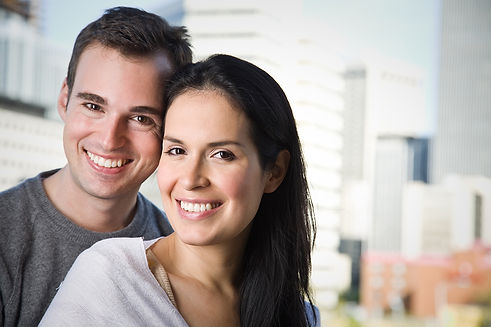 Couple with bright teeth promoting Cosmetic Dentistry
