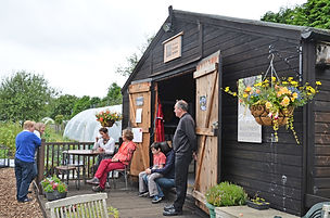 A community day at the Hutton hut with its new signage.