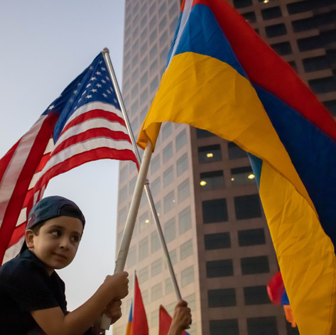 Hrag Demirjian, 6, proudly carries the flag of his homeland Armenia at the Protest against Azeri (Azerbaijan) and Turkish military agression in the Republic of Nagorno-Karabakh in front of Azerbaijan Los Angeles Consulate, in Los Angeles, Calif. on Wednesday, Sept. 30, 2020.