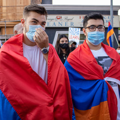 Martirosyan, 19, and friend Vahan Harutyunyan, 18, attend a protest draped in Armenian Flags at an Armenians against Azeri (Azerbaijan) and Turkish military aggression in the Republic of Nagorno-Karabakh in front of the  Republic of Azerbaijan Los Angeles Consulate, in Los Angeles, Calif. on Wednesday, Sept. 30, 2020.