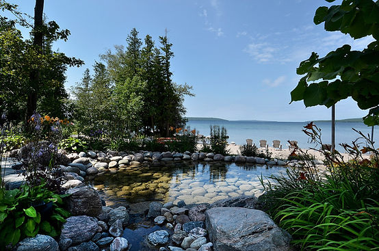 The Great Lodge gardens, natural ponds and streams on beach at Georgian Bay, Ontario