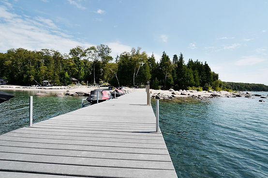 Dock and private beach at luxury waterfront cottage rental The Great Lodge on Georgian Bay