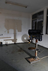 Archive of Lost Traits, A classroom installtion a a long deserted vocational school. Tools, textbooks and shadows of the past remain a testimony to an abandoned educational surrounding