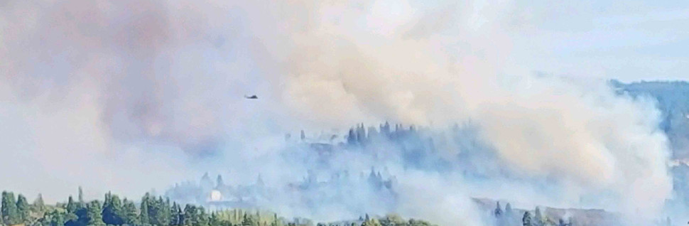 Fire helicopters and airplanes douse water on Mosier Creek Fire 8.12.20. The air support on this fire has been incrediable