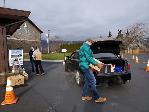 Volunteers load up PPE to business owner cars.jpeg