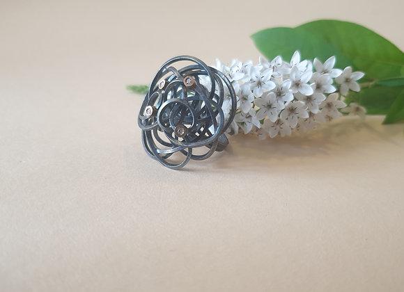 Zilveren ring met goud en briljant