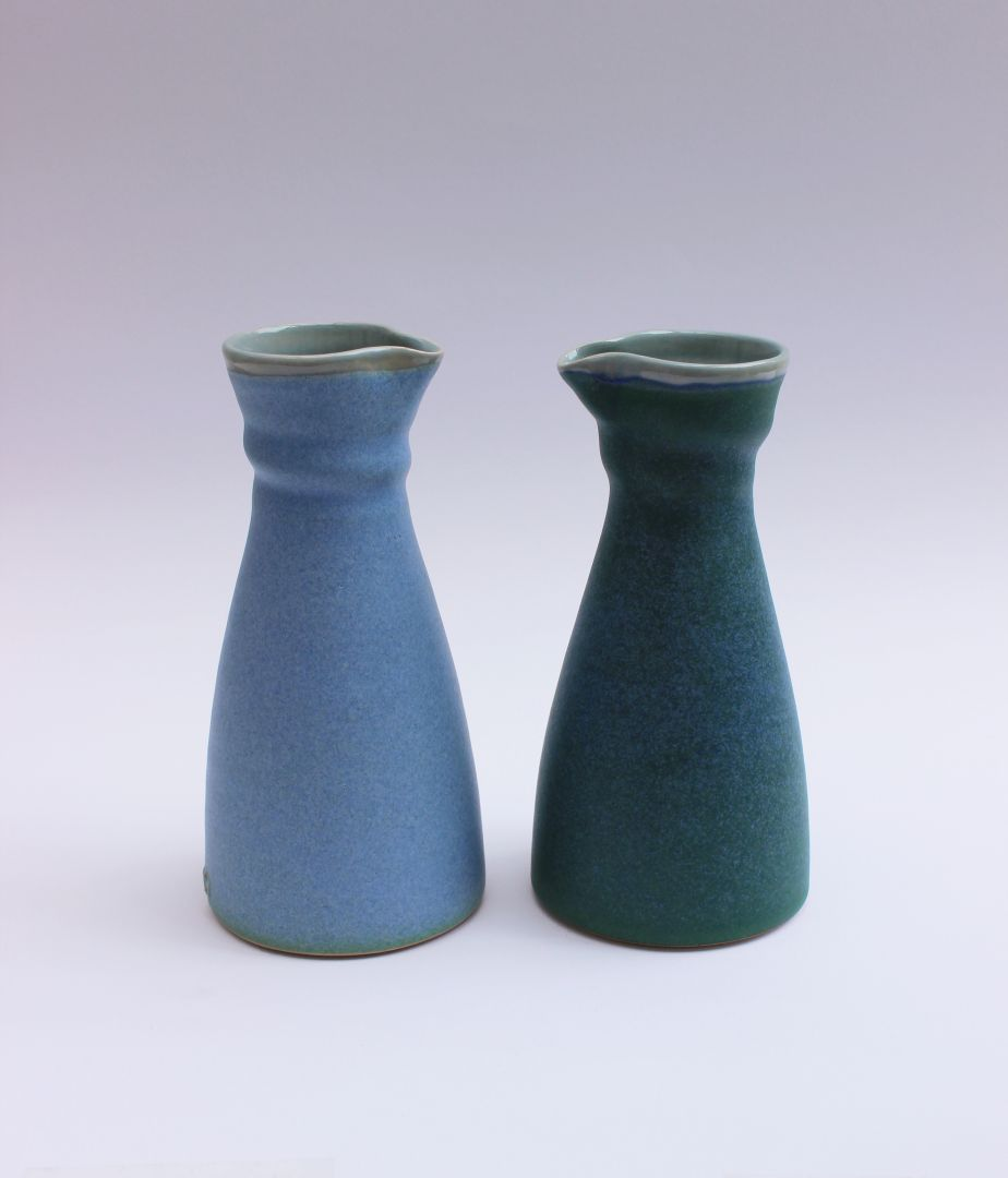 blue and green carafes