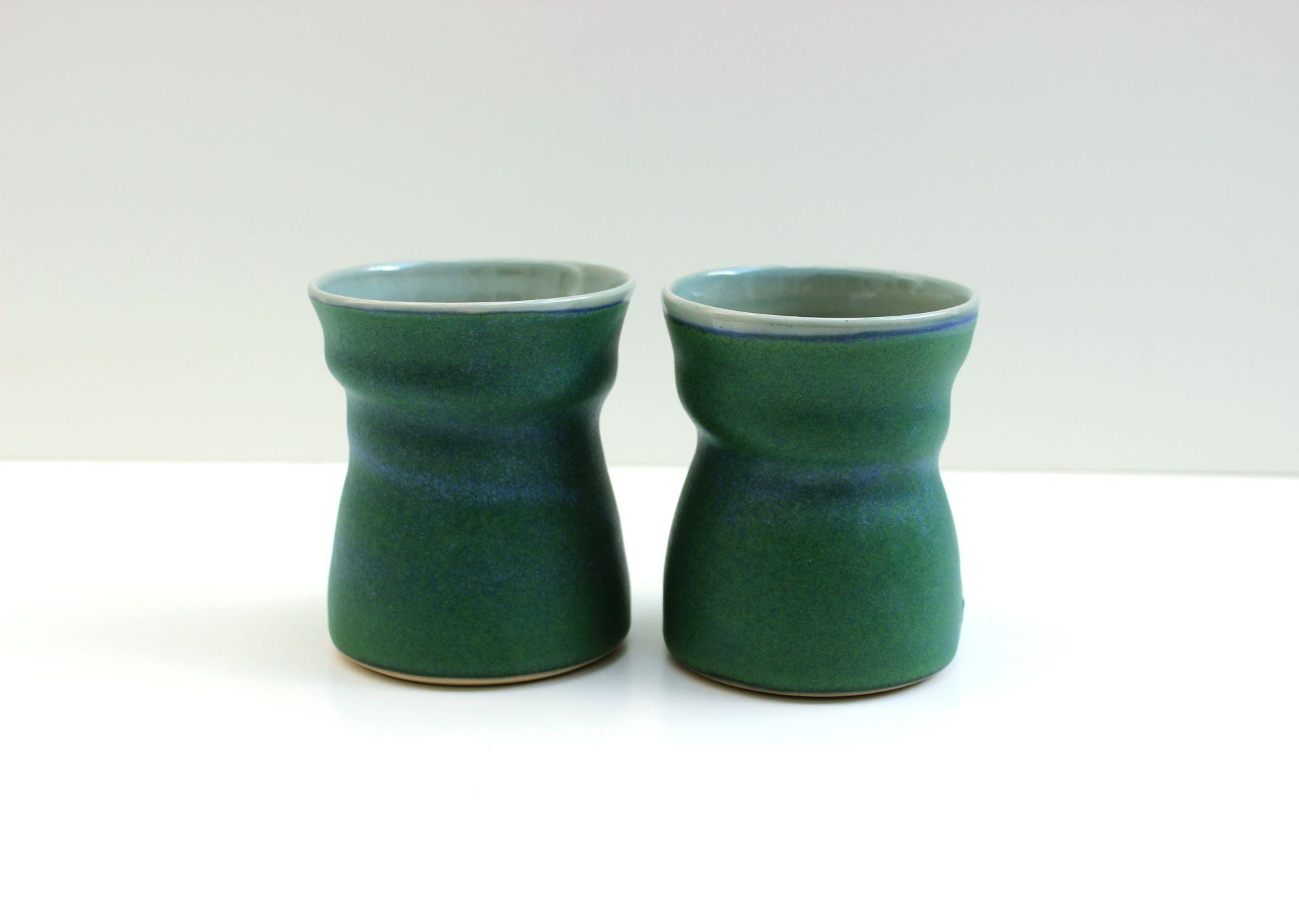 green beakers