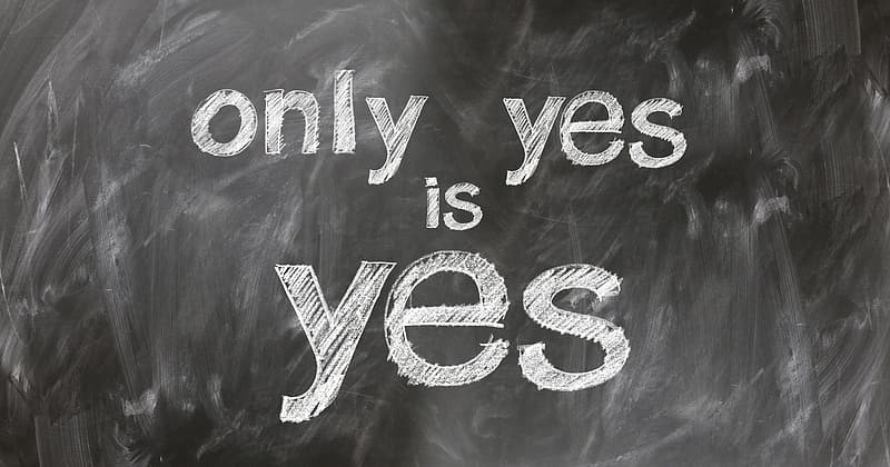 Chalk letters on a board that say ONLY YES IS YES