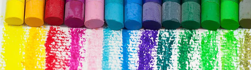 Rainbow of chalk writing on white paper