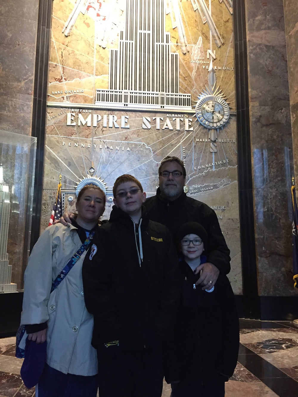 A photo of david brodosi and his family at the Empire State building