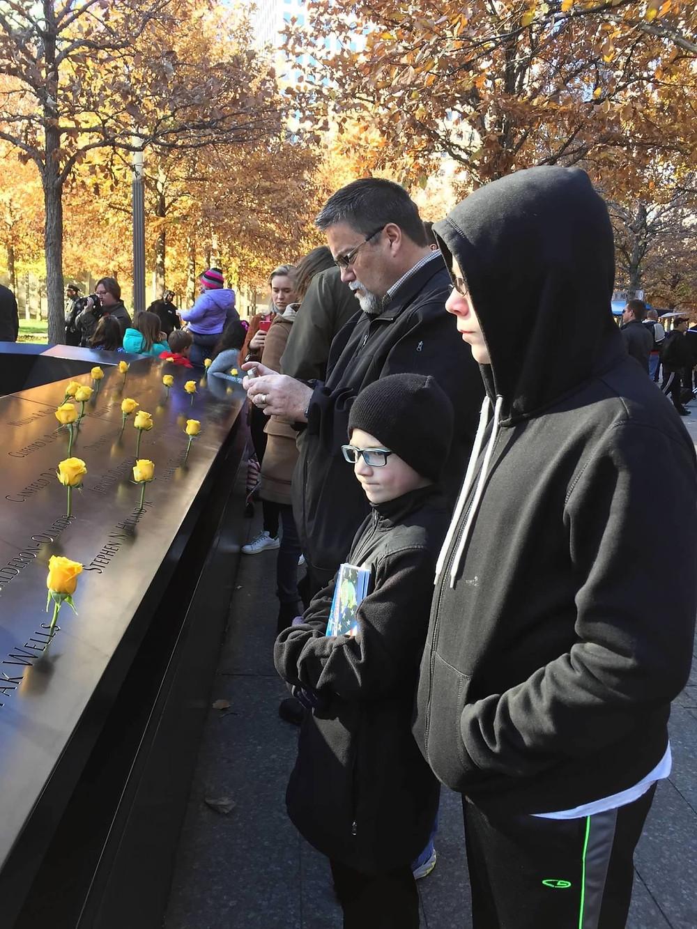 A photo of david brodosi and his family at the Trade Center Memorial