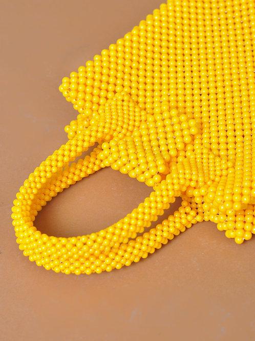 Baba bolso de cuentas amarillo
