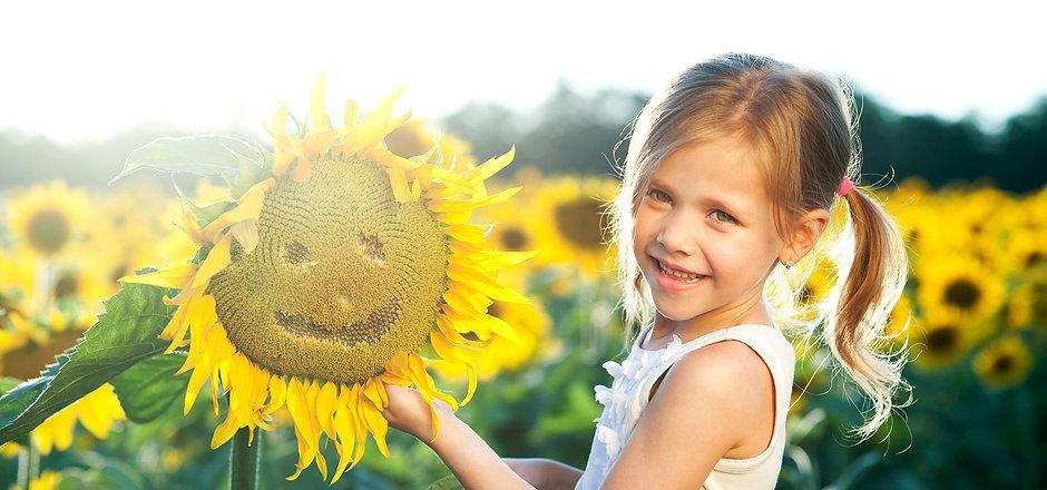 Girl with sunflower.jpg