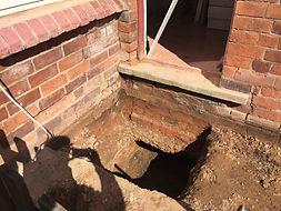 underpinning under subsidence damaged wall