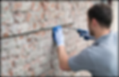 Showing how to brick stitch a cracked wall