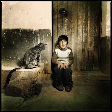 """Child with big cat"", Puno 2007"