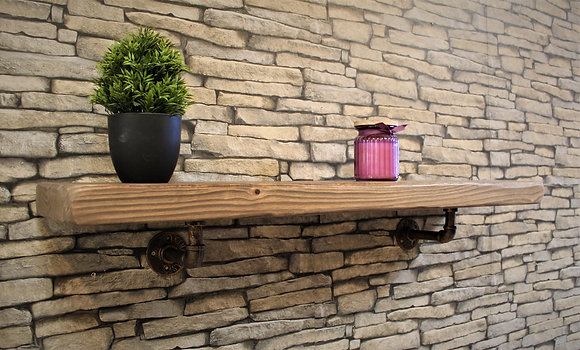 Rustic solid wood shelf paired with industrial brackets