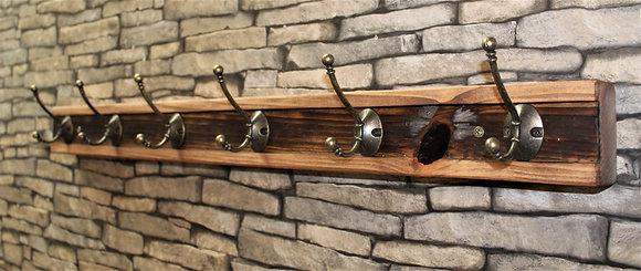 Two tone 6 hook coat rack.