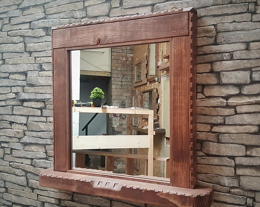 Mirror with castellated detail and shelf.